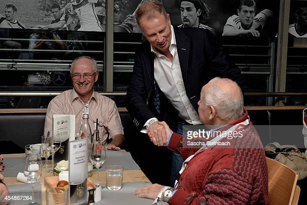 Willi Neuberger Stefan Reuter and Dieter 'Hoppy' Kurrat shake hands during the 'Club Of Former National Players' meeting prior to the EURO 2016...