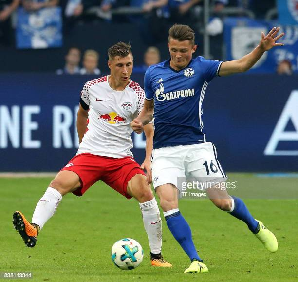 Willi Orban and Fabian Reese of Schalke battle for the ball during the Bundesliga match between FC Schalke 04 and RB Leipzig at VeltinsArena on...