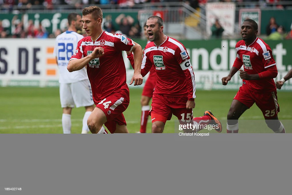 Willi Orban of Kaiserslautern (L) cel2 with <a gi-track='captionPersonalityLinkClicked' href=/galleries/search?phrase=Marc+Torrejon&family=editorial&specificpeople=4219506 ng-click='$event.stopPropagation()'>Marc Torrejon</a> (2nd L) and <a gi-track='captionPersonalityLinkClicked' href=/galleries/search?phrase=Olivier+Occean&family=editorial&specificpeople=747391 ng-click='$event.stopPropagation()'>Olivier Occean</a> of Kaiserslautern during the the Second Bundesliga match between 1. FC Kaiserslautern and Karlsruher SC at Fritz-Walter-Stadion on October 20, 2013 in Kaiserslautern, Germany.