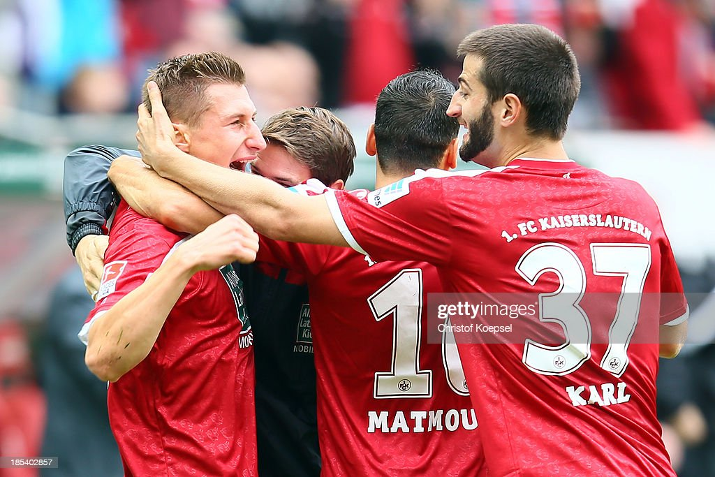 Willi Orban of Kaiserslautern celebrates the second goal with, <a gi-track='captionPersonalityLinkClicked' href=/galleries/search?phrase=Karim+Matmour&family=editorial&specificpeople=741965 ng-click='$event.stopPropagation()'>Karim Matmour</a> and Markus Karl of Kaiserslautern during the the Second Bundesliga match between 1. FC Kaiserslautern and Karlsruher SC at Fritz-Walter-Stadion on October 20, 2013 in Kaiserslautern, Germany.