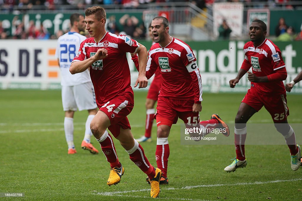Willi Orban of Kaiserslautern (L) celebrates the second goal with <a gi-track='captionPersonalityLinkClicked' href=/galleries/search?phrase=Marc+Torrejon&family=editorial&specificpeople=4219506 ng-click='$event.stopPropagation()'>Marc Torrejon</a> (2nd L) and <a gi-track='captionPersonalityLinkClicked' href=/galleries/search?phrase=Olivier+Occean&family=editorial&specificpeople=747391 ng-click='$event.stopPropagation()'>Olivier Occean</a> of Kaiserslautern during the the Second Bundesliga match between 1. FC Kaiserslautern and Karlsruher SC at Fritz-Walter-Stadion on October 20, 2013 in Kaiserslautern, Germany.