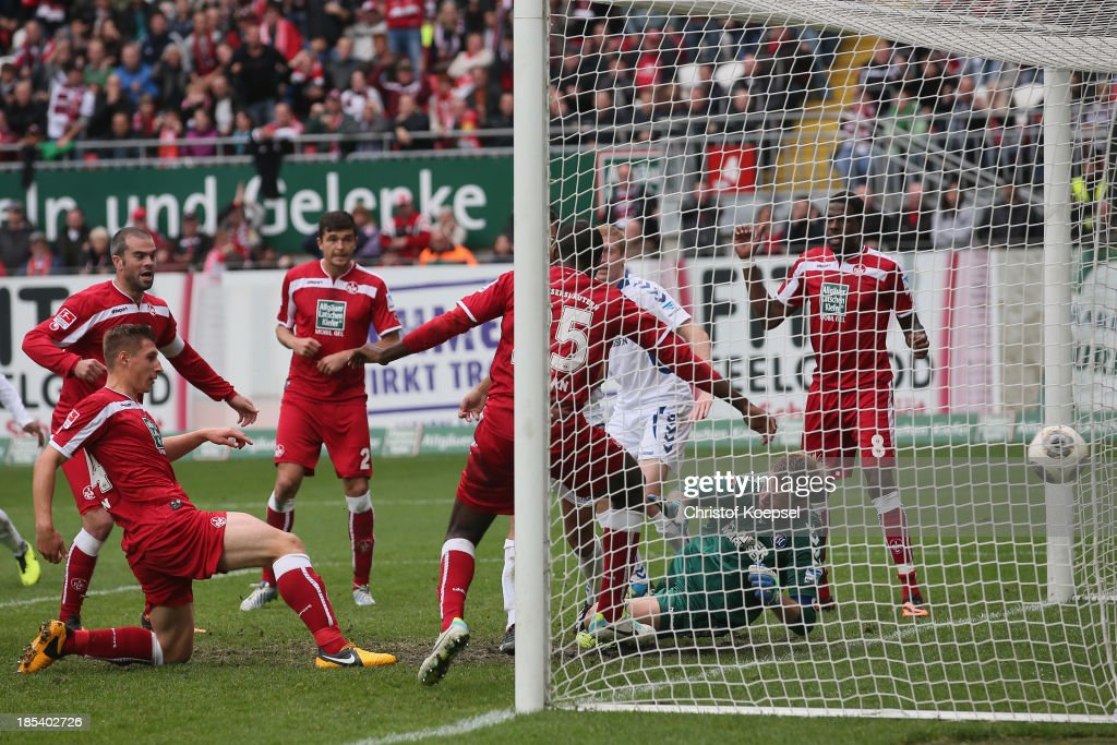 Willi Orban of Kaiserslautern (L) scores the second goal during the the Second Bundesliga match between 1. FC Kaiserslautern and Karlsruher SC at Fritz-Walter-Stadion on October 20, 2013 in Kaiserslautern, Germany.