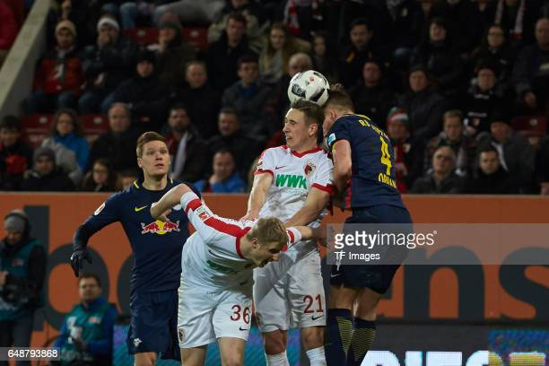 Willi Orban of Leipzig and Dominik Kohr of Augsburg battle for the ball during the Bundesliga match between FC Augsburg and RB Leipzig at WWK Arena...