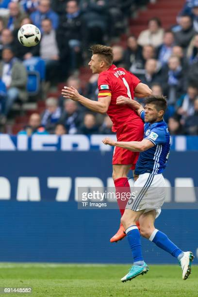 Willi Orban of Leipzig and KlaasJan HUNTELAAR of Schalke battle for the ball during the Bundesliga match between FC Schalke 04 and RB Leipzig at...