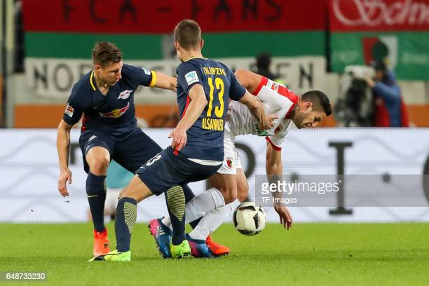 Willi Orban of Leipzig Stefan Ilsanker of Leipzig and Raul Bobadilla of Augsburg battle for the ball during the Bundesliga match between FC Augsburg...