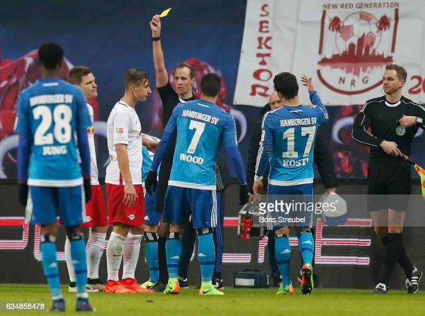 Willi Orban of RB Leipzig is shown a yellow card by referee Sascha Stegemann during the Bundesliga match between RB Leipzig and Hamburger SV at Red...