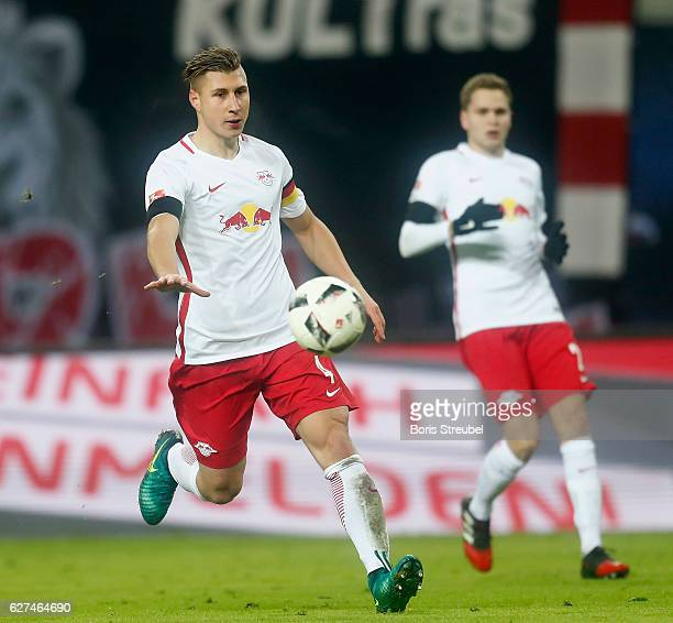 Willi Orban of RB Leipzig runs with the ball during the Bundesliga match between RB Leipzig and FC Schalke 04 at Red Bull Arena on December 3 2016 in...
