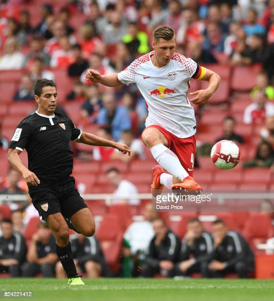 Willi Orban of RB Leipzig under pressure from Wissam Ben Yedder of Sevilla during the match RB Leipzig and Sevilla at Emirates Stadium on July 29...