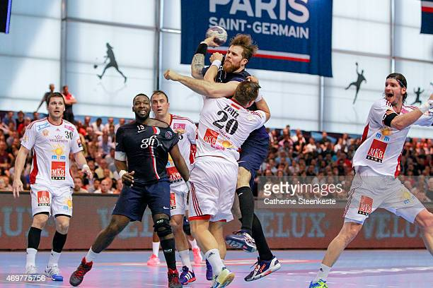 William Accambray of Paris SaintGermain Handball tries to shoot the ball against Christian Zeitz of MKBMVM Veszprem during the EHF Men's Champions...