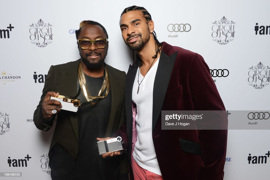Will.i.am and <a gi-track='captionPersonalityLinkClicked' href=/galleries/search?phrase=David+Haye&family=editorial&specificpeople=220778 ng-click='$event.stopPropagation()'>David Haye</a> attend the I.AM+ foto.sosho Launch Party in association with Cirque Du Soir at One Marylebone on December 16, 2012 in London, England.