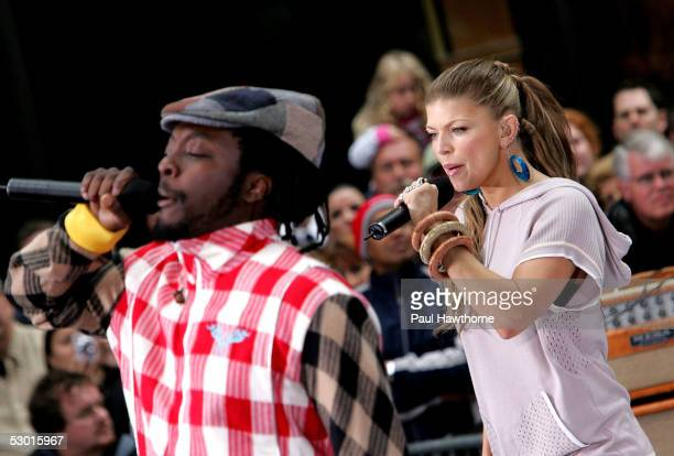 WillIAm and Fergie of the Black Eyed Peas perform onstage during the Toyota Concert Series on the 'Today' Show June 3 2005 in New York City