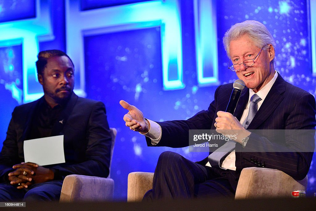 will.i.am and former President <a gi-track='captionPersonalityLinkClicked' href=/galleries/search?phrase=Bill+Clinton&family=editorial&specificpeople=67203 ng-click='$event.stopPropagation()'>Bill Clinton</a> speak at <a gi-track='captionPersonalityLinkClicked' href=/galleries/search?phrase=Will.I.Am&family=editorial&specificpeople=203050 ng-click='$event.stopPropagation()'>Will.I.Am</a>'s Annual TRANS4M Day Conference on TRANS4Ming America on February 7, 2013 in Los Angeles, California.