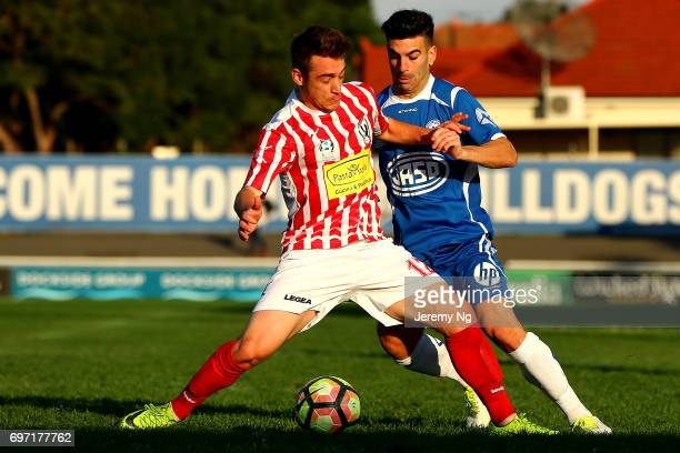 William Angel of Olympic and Marcus Donatiello of Parramatta FC challenge for the ball during the NSW NPL Men's match between Sydney Olympic FC and...
