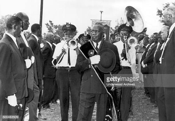 William 'Baba' Ridgley one of the last of the oldtime jazz musicians is laid to rest in New Orleans to the accompaniment of a slowshuffling jazz band...