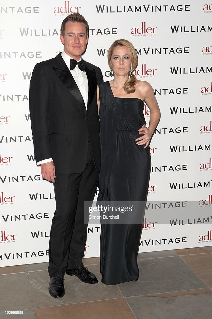 William Banks and <a gi-track='captionPersonalityLinkClicked' href=/galleries/search?phrase=Gillian+Anderson&family=editorial&specificpeople=202894 ng-click='$event.stopPropagation()'>Gillian Anderson</a> attend the WilliamVintage Dinner Sponsored By Adler at St Pancras Renaissance Hotel on February 8, 2013 in London, England.