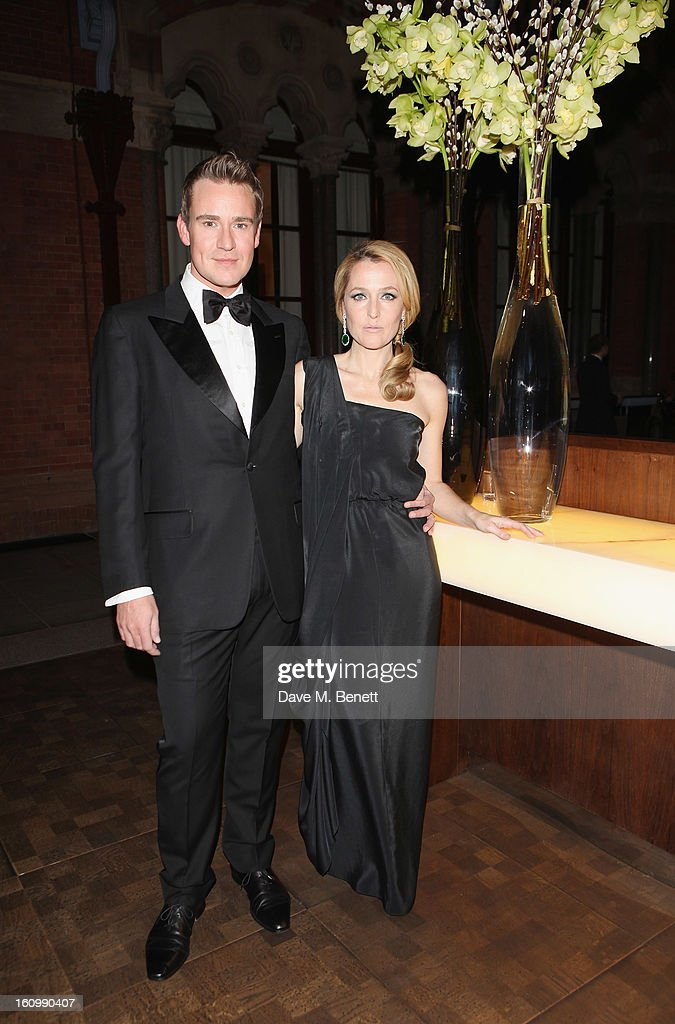 William Banks Blaney and <a gi-track='captionPersonalityLinkClicked' href=/galleries/search?phrase=Gillian+Anderson&family=editorial&specificpeople=202894 ng-click='$event.stopPropagation()'>Gillian Anderson</a> attend the WilliamVintage Dinner hosted by <a gi-track='captionPersonalityLinkClicked' href=/galleries/search?phrase=Gillian+Anderson&family=editorial&specificpeople=202894 ng-click='$event.stopPropagation()'>Gillian Anderson</a> and William Banks-Blaney in association with Adler at St Pancras Renaissance Hotel on February 8, 2013 in London, England.