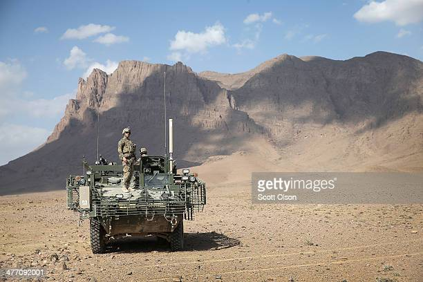 William Berczik from Houston Texas wth 4th Squadron 2d Cavalry Regiment stands on top of a Stryker vehicle following a livefire exercise with 120mm...