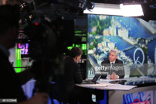 William 'Bill' Ackman founder and chief executive officer of Pershing Square Capital Management LP right speaks during a Bloomberg Television...