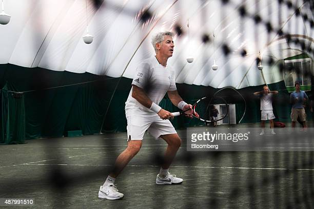 William 'Bill' Ackman founder and chief executive officer of Pershing Square Capital Management LP center is seen through a net during the Wall...