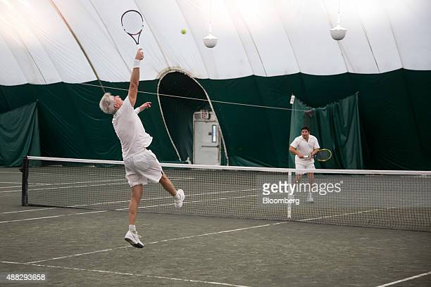 William 'Bill' Ackman founder and chief executive officer of Pershing Square Capital Management LP competes in a doubles match during the first...