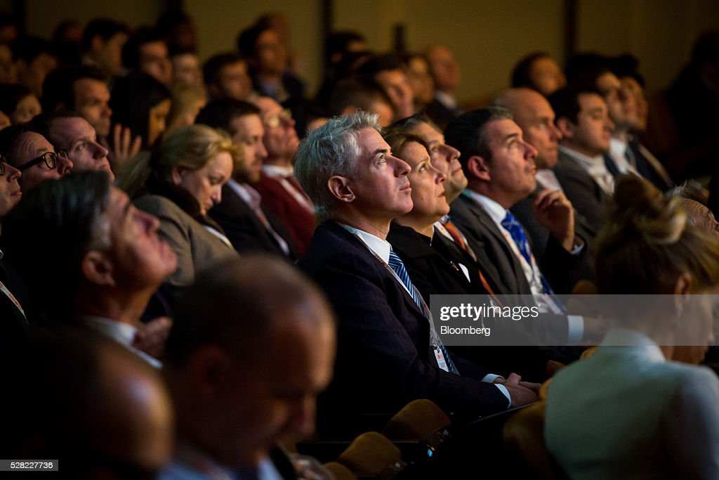 William 'Bill' Ackman, founder and chief executive officer of Pershing Square Capital Management LP, center, listens during the 21st annual Sohn Investment Conference in New York, U.S., on Wednesday, May 4, 2015. Since 1996 the Sohn Investment Conference has brought together the world's savviest investors to share fresh insights and strategies in support of pediatric cancer research and treatment. Photographer: Michael Nagle/Bloomberg via Getty Images