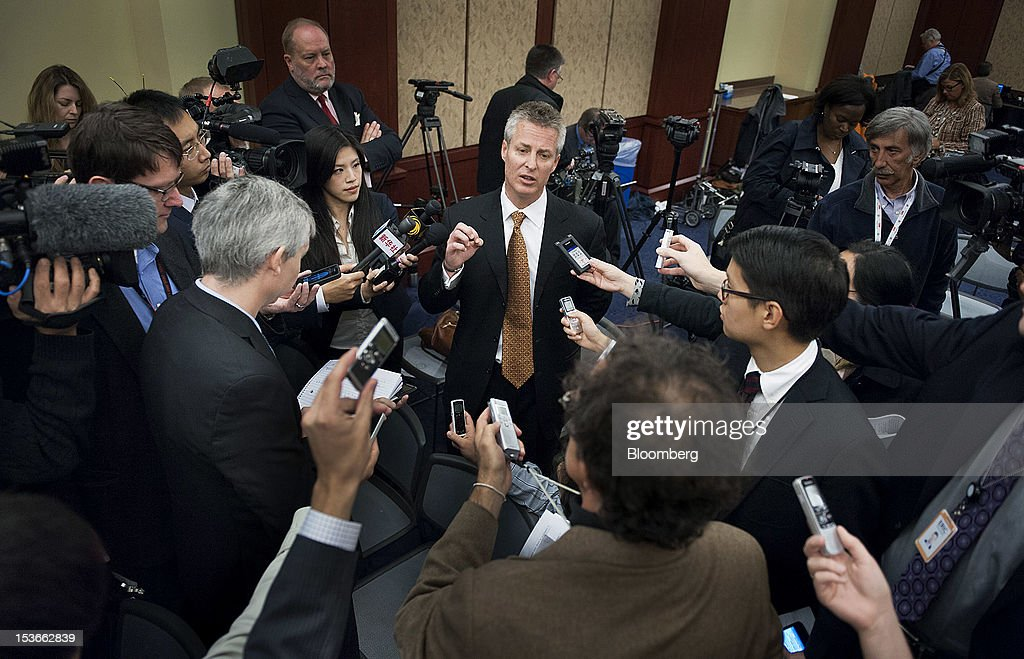 William 'Bill' Plummer, vice president of external affairs for Huawei Technologies Co. Ltd., center, speaks to the media following a news conference in Washington, D.C., U.S., on Monday, Oct. 8, 2012. U.S. companies should avoid business with Huawei Technologies Co., China's largest phone-equipment maker, to guard against intellectual-property theft and spying, the U.S. House Intelligence Committee chairman said. Photographer: Jay Mallin/Bloomberg via Getty Images