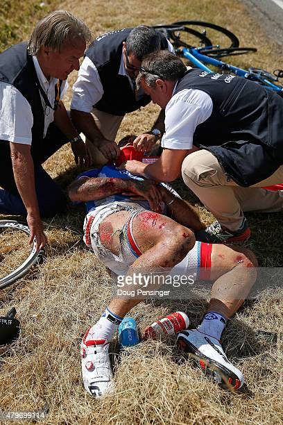 William Bonnet of France riding for FDJ is attended to after being involved in a crash with 65km remaining in stage three of the 2015 Tour de France...