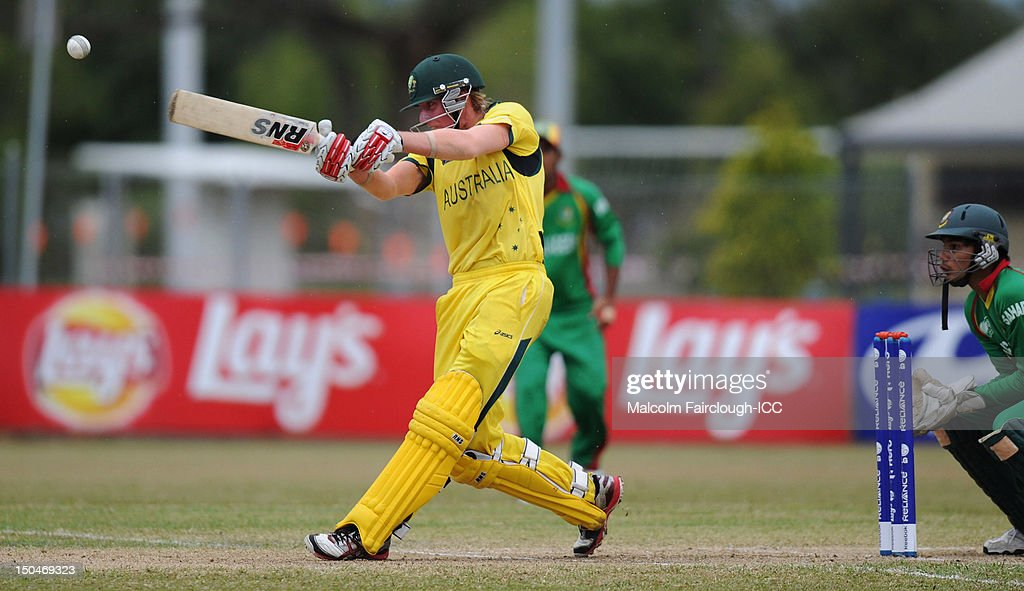 William Bosisto hits the ball down the ground during the ICC U19 Cricket World Cup 2012 Quarter Final match between Australia and Bangladesh at Endeavour Park on August 19, 2012 in Townsville, Australia.