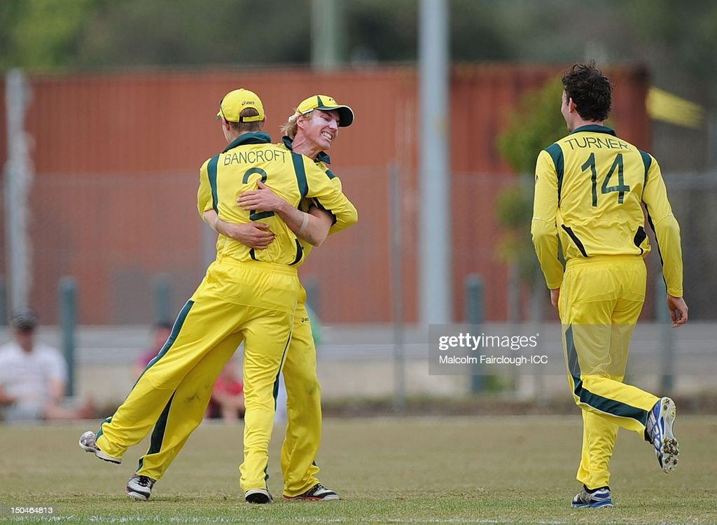 William Bosisto (L) of Australia celebrates the runout of Litton Kumar Das from a direct hit on the stumps by Cameron Bancroft (C) as Travis Head looks on during the ICC U19 Cricket World Cup 2012 Quarter Final match between Australia and Bangladesh at Endeavour Park on August 19, 2012 in Townsville, Australia.