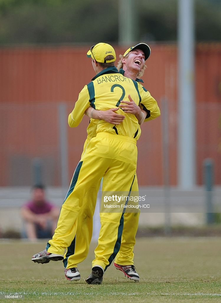 William Bosisto of Australia celebrates the runout of Litton Kumar Das from a direct hit on the stumps by Cameron Bancroft (2) during the ICC U19 Cricket World Cup 2012 Quarter Final match between Australia and Bangladesh at Endeavour Park on August 19, 2012 in Townsville, Australia.