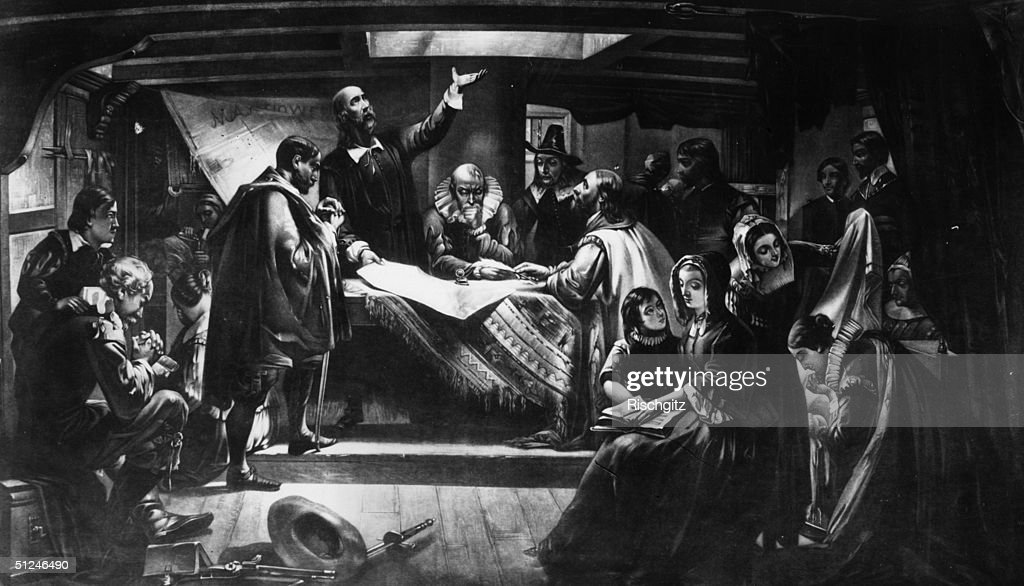 1620 William Bradford at the 'Signing of the Compact in the cabin of the 'Mayflower' after Edwin White L to r by the table Capt Miles Standish Elder...