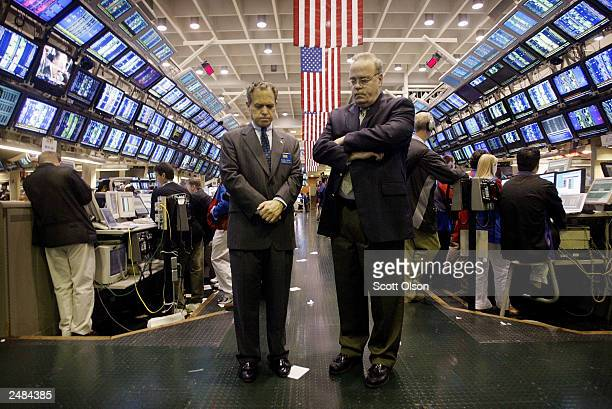William Brodsky Chairman and CEO of the Chicago Board of Options Exchange and Ed Joyce President and COO of the CBOE bow their heads during a minute...