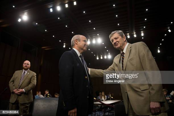 William Browder chief executive officer of Hermitage Capital Management is greeted by Sen John Kennedy before the start of a Senate Judiciary...