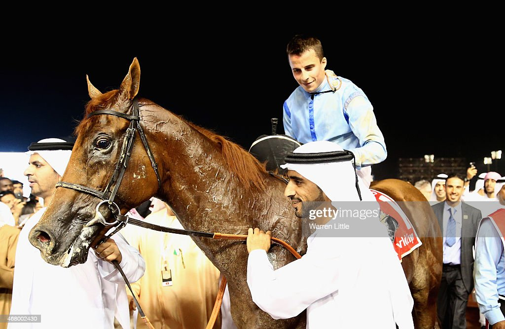 <a gi-track='captionPersonalityLinkClicked' href=/galleries/search?phrase=William+Buick&family=editorial&specificpeople=3912320 ng-click='$event.stopPropagation()'>William Buick</a> is congratulated by Prince Bishop owner, Hamdan bin Mohammed bin Rashid Al Maktoum, Crown Prince of Dubai after winning the Dubai World Cup at the Meydan Racecourse on March 28, 2015 in Dubai, United Arab Emirates.