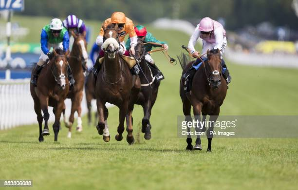 William Buick on Wannabe Yours wins the Bonhams Thoroughbred Stakes from Frederik Tylicki on Hors De Combat during day four of Glorious Goodwood at...