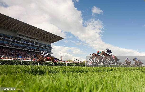 William Buick riding Arctic Cosmos win The Ladbrokes St Leger Stakes at Doncaster racecourse on September 11 2010 in Doncaster England