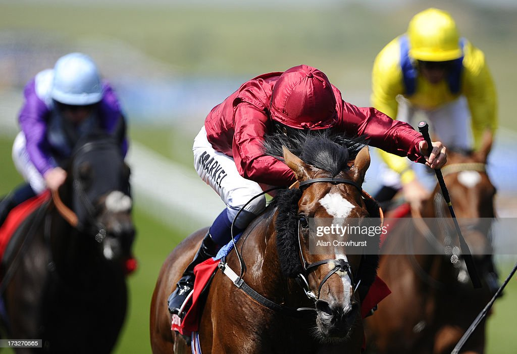 William Buick riding Feel Like Dancing (C) to win The Bahrain Trophy at Newmarket racecourse on July 11, 2013 in Newmarket, England.