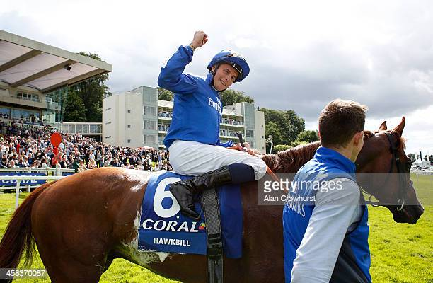 William Buick riding Hawkbill celebrate winning The CoralEclipse at Sandown Park on July 02 2016 in Esher England