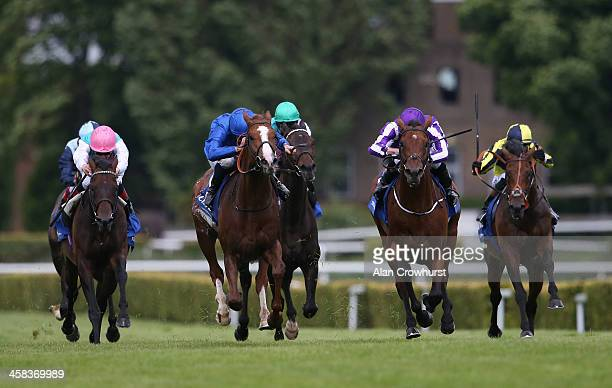 William Buick riding Hawkbill win The CoralEclipse from The Gurkha and Ryan Moore at Sandown Park on July 02 2016 in Esher England