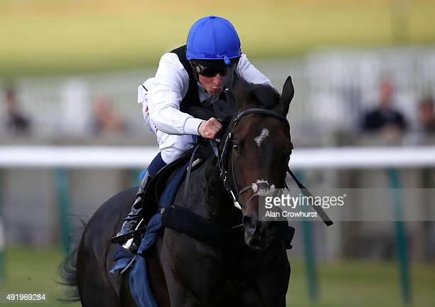 William Buick riding Jack Hobbs gallops before racing at Newmarket racecourse on October 09 2015 in Newmarket England