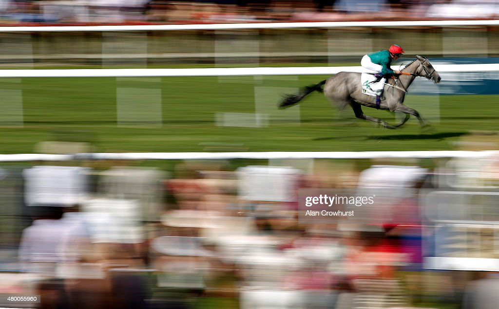 William Buick riding Lumiere easily win The John Deere EBF Stallions Maiden Fillies' Stakes at Newmarket racecourse on July 09 2015 in Newmarket...
