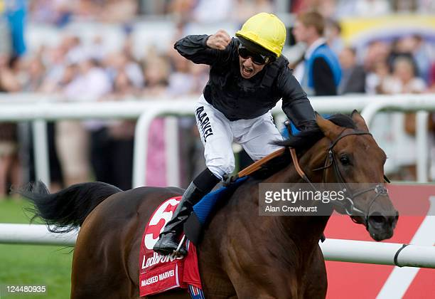 William Buick riding Masked Marvel win The Ladbrokes St Leger Stakes at Doncaster racecourse on September 10 2011 in Doncaster England