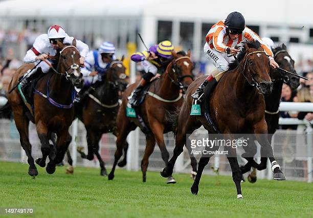 William Buick riding Ortensia win The Gordon's King George Stakes at Goodwood racecourse on August 03 2012 in Chichester England