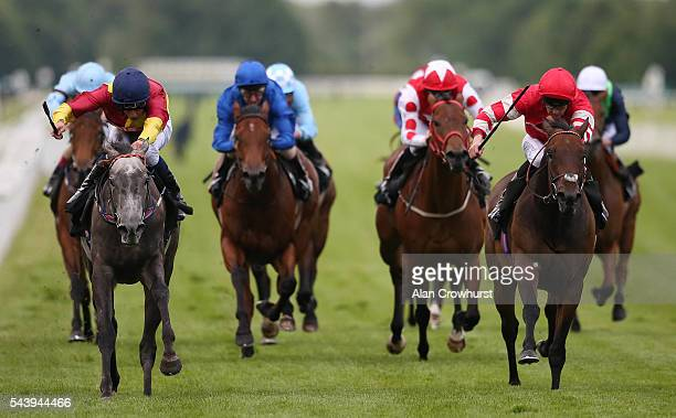 William Buick riding Silver Rainbow win The Coolmore Stud EBF Fillies' Handicap Stakes at Newbury racecourse on June 30 2016 in Newbury England