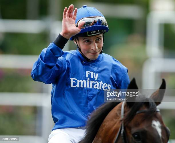 William Buick waves after riding Blue Point to win The John Guest Bengough Stakes at Ascot racecourse on October 7 2017 in Ascot United Kingdom