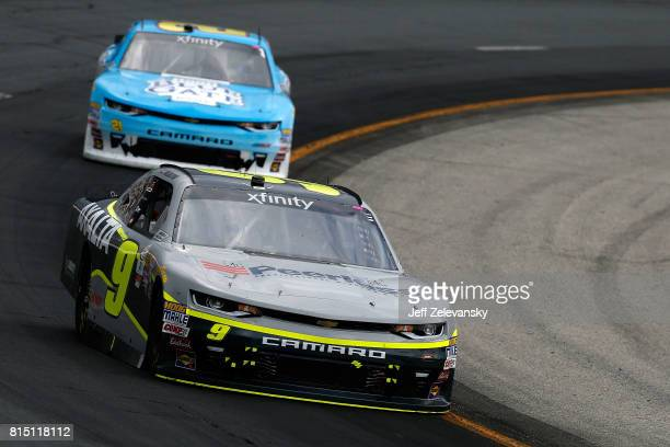 William Byron driver of the AXALTA/Peerless Chevrolet leads Daniel Hemric driver of the Blue Gate Bank Chevrolet during the NASCAR XFINITY Series...