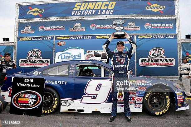 William Byron driver of the Liberty University Chevrolet celebrates in victory lane after winning the NASCAR KN Pro Series East Granite State 70 at...