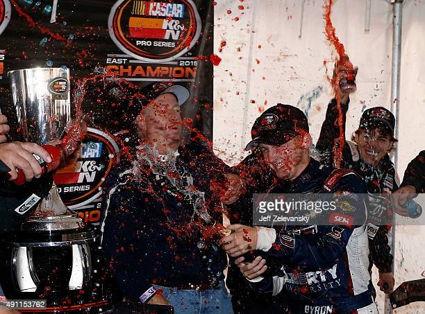 William Byron driver of the Liberty University Chevrolet celebrates winning the series championship following the NASCAR KN Pro Series East Drive...