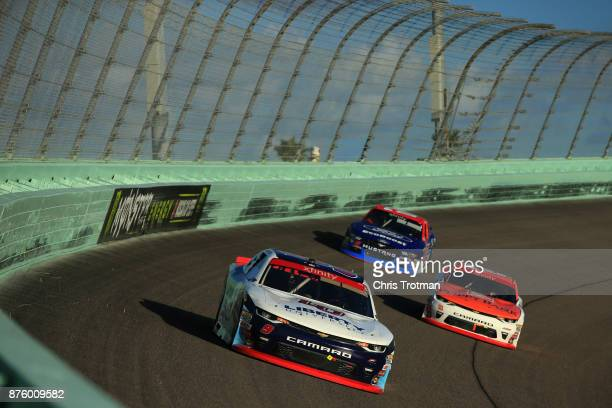 William Byron driver of the Liberty University Chevrolet leads Daniel Hemric driver of the Poppy Bank Chevrolet and Elliott Sadler driver of the...