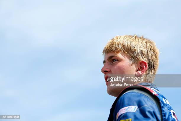 William Byron driver of the Liberty University Chevrolet stands on the grid during qualifying for the NASCAR KN Pro Series East Granite State 70 at...